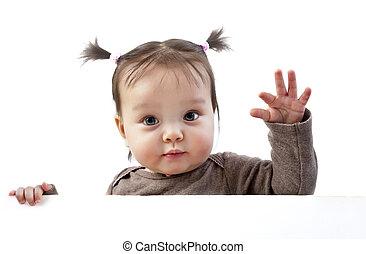 Baby above banner waving hand