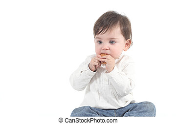 Baby absorbed eating a cookie