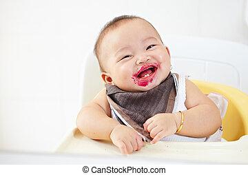 Baby girl after being eating loking at camera smiling