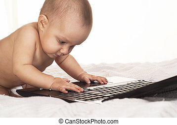 baby and a laptop
