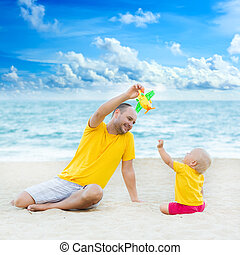 Baby and father playing toy plane - Baby and father on the...