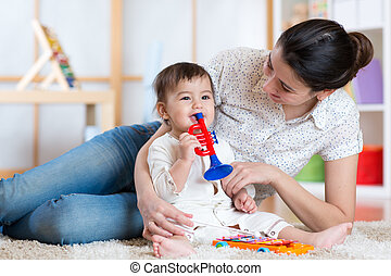 baby and her mother play musical toys - baby and mom playing...