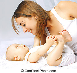 Baby and mother in bed