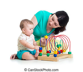 baby and mother play with color educational toy