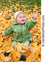 baby at a park in Autumn