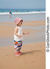 baby at beach asking