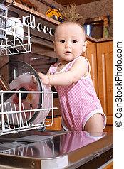 baby at dishwasher in kitchen