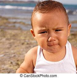 baby at the beach near the shore