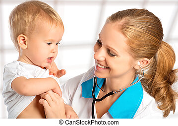 baby at the doctor pediatrician. doctor listens to the heart...