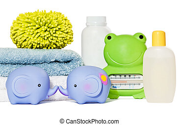 Baby bath accessories isolated: towels, toys, sponge, thermometer and bottles with copy space