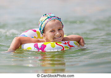 Baby bathing in the sea
