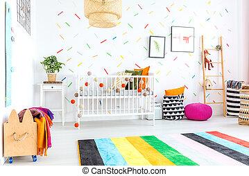 Baby bedroom in scandinavian style with wooden bed