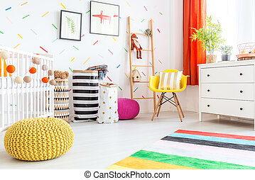 Baby bedroom with yellow pouf