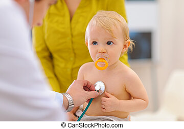 Baby being checked by pediatric doctor using stethoscope
