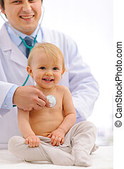 Baby being checked by pediatrician doctor using stethoscope