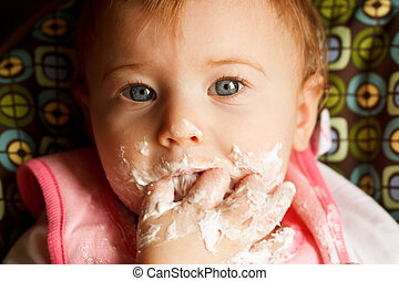 Baby Birthday Cake - Baby girl making a mess while feeding...
