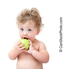 baby biting a green Apple on white background