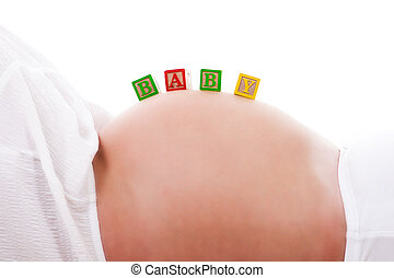 Baby Blocks on a Pregnant Woman's Stomach - Isolated