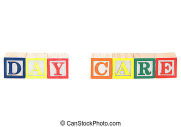 Baby blocks spelling day care. Isolated on a white...