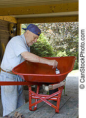 baby boomer painter 1 - Senior baby boomer male painting a...