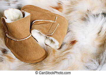 Baby boots - Pair of brown winter boots on fox fur...