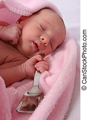 Baby born with silver spoon in her mouth