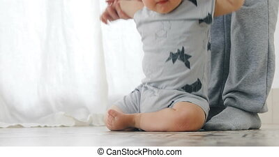Baby boy 1 year old walking his first steps - The kid is...