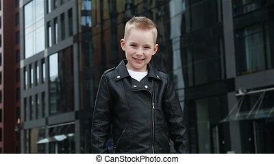 baby boy 7 - 8 years in a black leather jacket - baby boy 7...