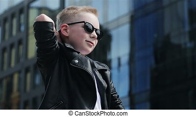 baby boy 7 - 8 years in sunglasses - baby boy 7 - 8 years is...