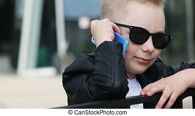 baby boy 7 - 8 years in sunglasses with phone - baby boy 7 -...