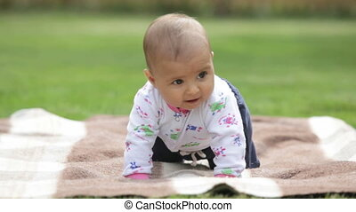 Baby boy - Adorable baby boy on the blanket outdoor