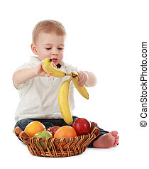 baby boy and fruits