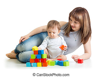 baby boy and his mom play with building blocks