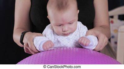Baby boy belches milk - In a denim shirt, a baby baby is...