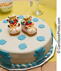 baby boy birthday cake with cute shoes
