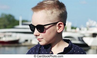 baby boy blond 8 years in a blue shirt - baby boy blond 8...