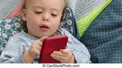 Baby boy child watching video smartphone