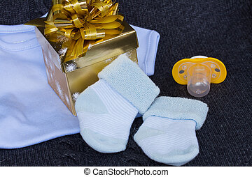 baby boy clothes with gift box