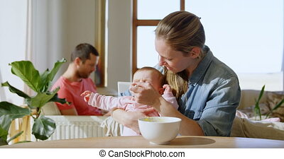 Baby boy crying while mother feeding him food 4k - Baby boy...