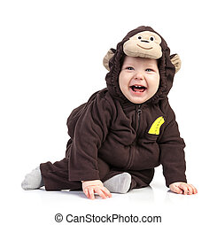 Baby boy dressed in monkey costume over white background