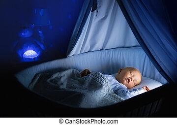 Baby boy drinking milk in bed