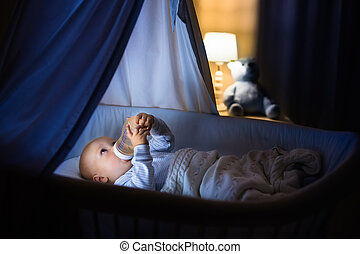 Baby boy drinking milk in bed - Adorable baby drinking milk...