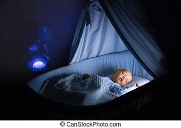 Baby boy drinking milk in bed - Adorable baby drinking milk...