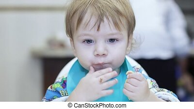 Baby boy eats spaghetti