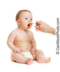 baby boy  feeding isolated on white