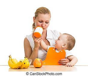 baby boy feeding mother