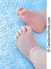 baby boy feet on blue blanket