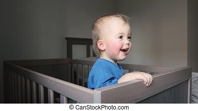 Baby boy hiding in crib crouching and disappeared - Infant...