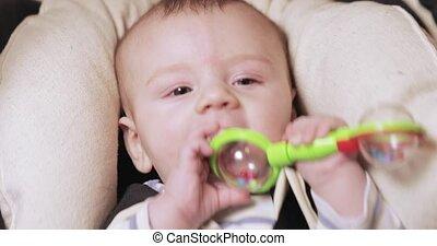 Baby boy in a rocking cradle