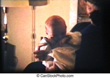 Baby Boy In Basinette (1962) - A proud mom gentle lays her...